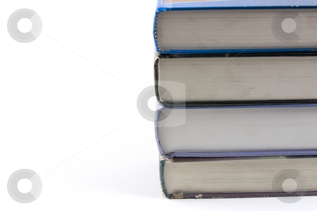 Close up on Old Books stock photo, Four Old Books stacked up by Mehmet Dilsiz