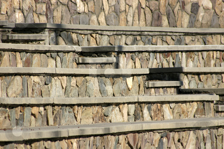 Rock Baseball Benches stock photo, Rocky benches in the Baseball Field by Mehmet Dilsiz