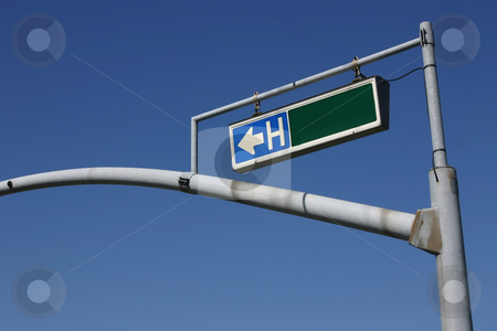 Traffic Light Pole with Hospital Sign stock photo, Traffic Light Pole with Hospital Sign - No Street Name by Mehmet Dilsiz