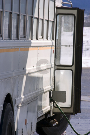 White School Bus Pumping Gas stock photo, White School Bus Pumping Gas by Mehmet Dilsiz