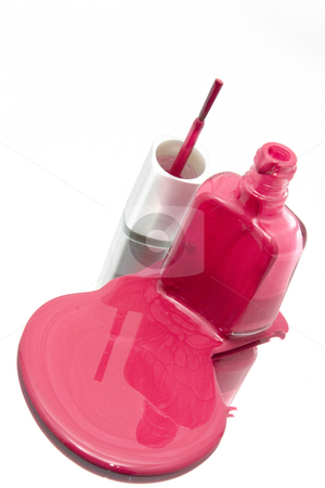 Nail Polish Spilling on a Mirror with the Brush Standing at an A stock photo, Isolated Nail Polish Spilling on a Mirror with the Brush Standing at an Angle by Mehmet Dilsiz