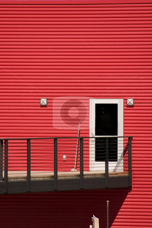 White Door with Red Walls stock photo, White Door with Red Siding Walls and the Patio by Mehmet Dilsiz