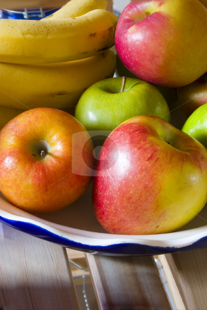 Apples and Bananas stock photo, Bowl of apples and bananas by Mehmet Dilsiz