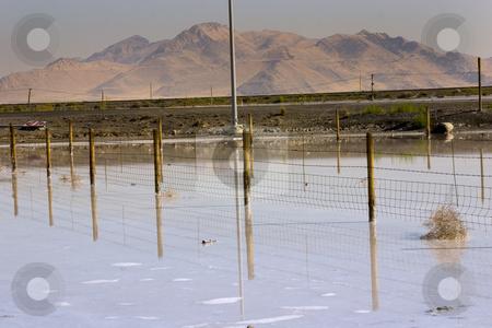 Salt Lake Shore stock photo, Mountains behind the White Salt Lake Deposits - Utah by Mehmet Dilsiz