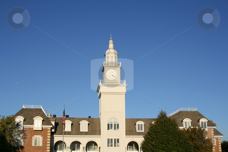 Close up on an Old Colonial Building in a Business Park stock photo, Old Colonial Building with Clock by Mehmet Dilsiz