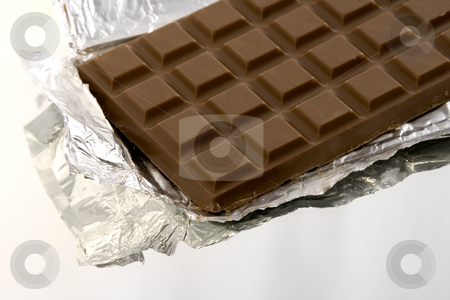 Isolated Chocolate Bar stock photo, Isolated Chocolate Bar on a Mirror inside the Wrapper by Mehmet Dilsiz