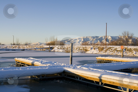 Docks on the Frozen Lake stock photo, Dockson the  Frozen Lake in Winter by Mehmet Dilsiz