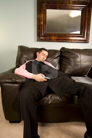 Businessman Sleeping on the Couch stock photo, Home or Office - Businessman Sleeping on the Couch by Mehmet Dilsiz
