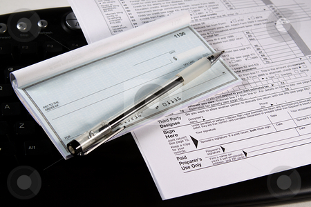 Preparing Taxes - Check and Forms on Keyboard stock photo, Preparing Taxes - Form 1040 for 2008 by Mehmet Dilsiz