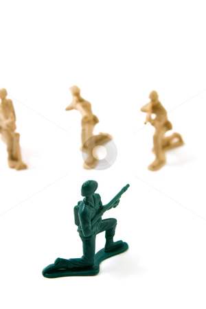 Courage Concept - One Soldier  stock photo, Isolated Plastic Toy Soldiers - Courage Concept by Mehmet Dilsiz