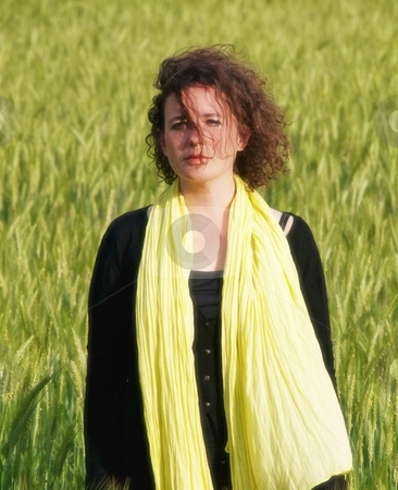 Woman in barley field stock photo, Photo of an attractive french woman wearing a yellow scarf standing in a green barley field by Laurent Dambies