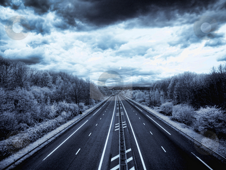 Infrared highway stock photo, Infrared picture of an empty highway under stormy sky by Laurent Dambies
