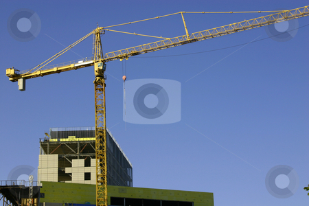 Construction site & the Crane stock photo, Construction site & the Crane - Zoomed in by Mehmet Dilsiz