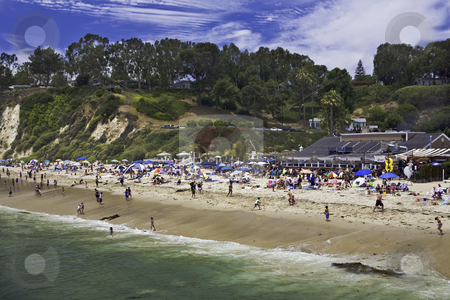 Beach Resort stock photo, Bathers crowd beach on a sunny day in California by Bart Everett
