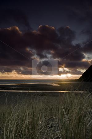 KareKare Sunset stock photo, Black sand?? by Robin Ducker