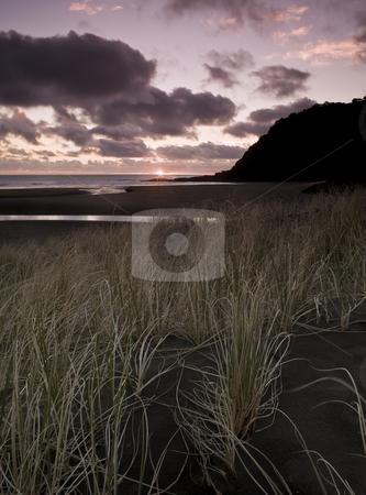 KareKare sundown stock photo, Black sand?? by Robin Ducker