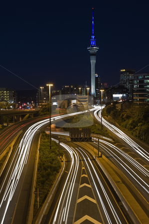 Rivers of life stock photo, Seeming to flow from the heart of Auckland, this shot of  car lights seem like a living moving river by Robin Ducker