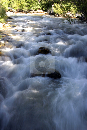 River stock photo, Flowing water in River by Mehmet Dilsiz