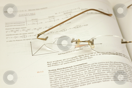 Glasses and the Statistics stock photo, Glasses and the Stats by Mehmet Dilsiz