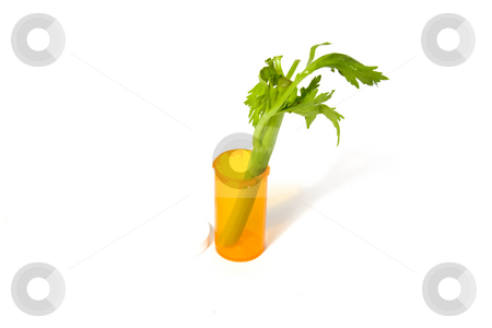 Alternative Medicine Concept stock photo, Celery in a medicine bottle - Alternative Medicine Concept by Mehmet Dilsiz