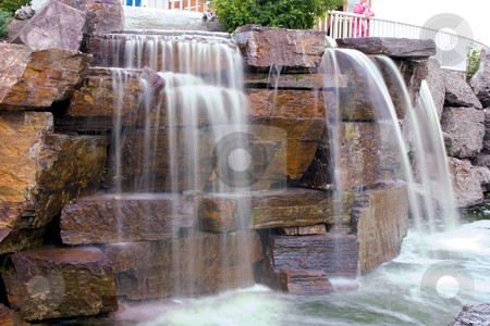 Small Waterfall in a Strip Mall stock photo, Small Waterfall in a Strip Mall in Montana by Mehmet Dilsiz