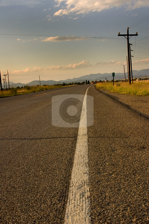 Road and the White Line on the Freeway stock photo, Freeway and the White Lane on the Side with Electric Poles by Mehmet Dilsiz