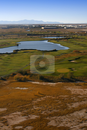 Overlooking at a Golf Course and a Pond stock photo, Aerial Shot of a Golf Course by Mehmet Dilsiz