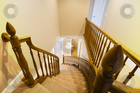 Looking down the Staircase in a Home stock photo, Looking down the Wooden Staircase in a Home by Mehmet Dilsiz