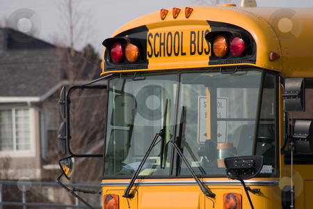 School Bus stock photo, Close up on a School Bus by Mehmet Dilsiz