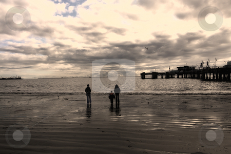 Family Walking on the Beach stock photo, Family Walking on Long Beach, California in a Cloudy Day by Mehmet Dilsiz