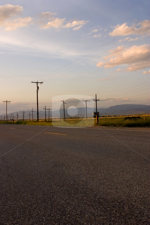 Road and the Field with the Electric Poles stock photo, Freeway and the Countryside with Electric Poles by Mehmet Dilsiz