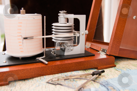 Barograph stock photo, Barograph in a wooden box with the lid open standing on a map by Keith Wilson