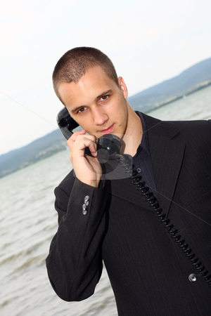 Businessman with retro phone stock photo, Businessman use old vintage dial telephone by Istv??n Cs??k