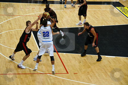 FIBA Trentino Cup: Italy vs Canada stock photo, Game 2 of FIBA Trentino Cup: Italy vs Canada. The tournament was played in Trento (Italy) between the 25th and the 27th of July 2009. Marco Belinelli shoots for a 3 points basket. Photo taken on the 25th of July, 2009. by Alessandro Rizzolli