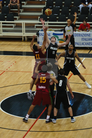 FIBA Trentino Cup: Portugal vs New Zealand stock photo, Game 1 of FIBA Trentino Cup: Portugal vs New Zealand. The tournament was played in Trento (Italy) between the 25th and the 27th of July 2009. New Zealand and Portugal players fight for the ball as the game strarts. Photo taken on the 25th of July, 2009. by Alessandro Rizzolli