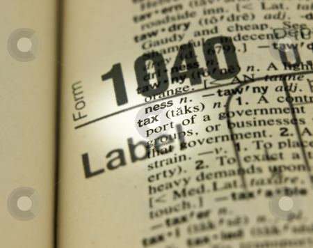 Close up of Tax with 1040 form stock photo, Close up of Tax definition with imposed 1040 form by John Teeter