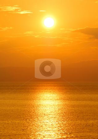 Setting sun stock photo, Image shows the sun setting over the Mediterranean Sea by Andreas Karelias