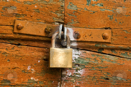 Security stock photo, Image shows a padlock on a highly textured door by Andreas Karelias