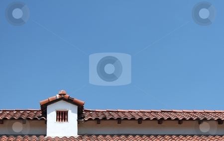 Roof stock photo, Roof top with small window and a blue sky in the background by Henrik Lehnerer