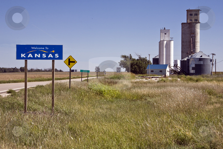 Welcome to Kansas West stock photo, Grain elevators in the tiny town of Saunders stand as greetings at the state line in western Kansas by Bart Everett