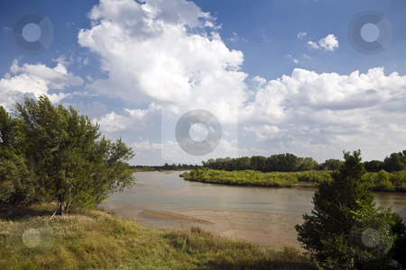 Arkansas River stock photo, The Arkansas River meanders over the plains north of Wichita, Kansas under a partly cloudy sky by Bart Everett