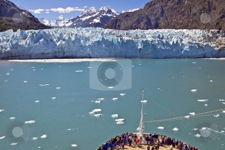Glacier Bay Cruise stock photo, A crowd gathers at the bow of a cruise ship as it approaches a glacier on the 