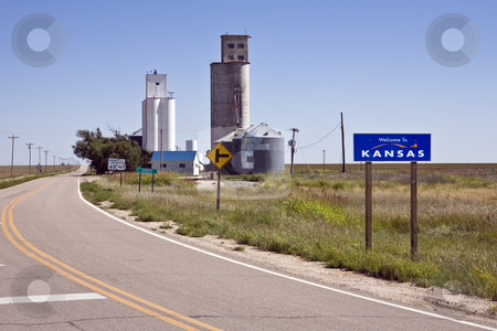 Welcome to Kansas stock photo, U.S. Highway 160 makes a slight jog as it enters Kansas from Colorado near grain elevators in the small town of Saunders by Bart Everett