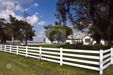Fenced Farmhouse and Barn stock photo, White rail fence surrounds tidy farmhouse in Kansas by Bart Everett