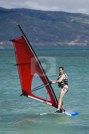 Girl Windsurfing at Kanaha Beach in Maui stock photo, Girl windsurfing on the coast of Maui by Bart Everett