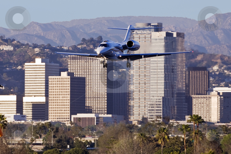 Century City Jet stock photo, Small jet airplane flies near Century City skyscrapers on landing approach to Santa Monica Airport by Bart Everett