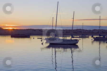 Morro Bay Harbor Sunset stock photo, Setting sunlight silhouettes  boats at anchor in Morro Bay in California by Bart Everett