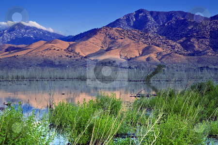 Lake Isabella at Dawn stock photo, The rising sun illuminates hills and mountains beyond the upper end of Lake Isabella in California by Bart Everett