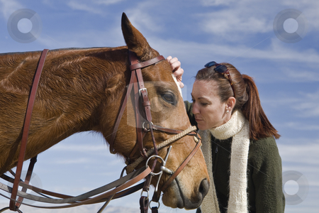 Horse Kiss stock photo, Young woman expresses affection for polo horse by Bart Everett