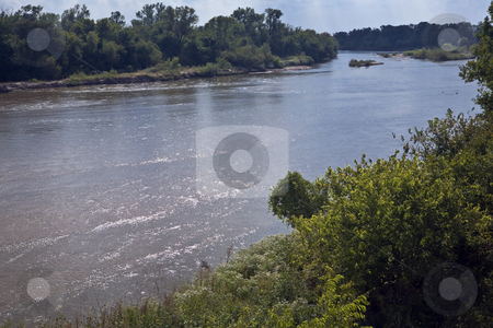 Arkansas River North of Wichita stock photo, Sunlight sparkles off ripples in Arkansas River north of Wichita, Kansas by Bart Everett